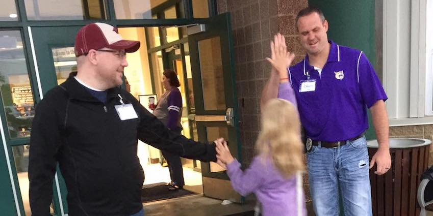 """Matt Sims of Southern Heights Baptist Church and Craig Hicks of the Berryville Police Department served among dozens of Bright Futures Berryville """"Champions"""" in April by greeting students every morning as they arrived for a day packed with standardized testing. The students loved it!"""