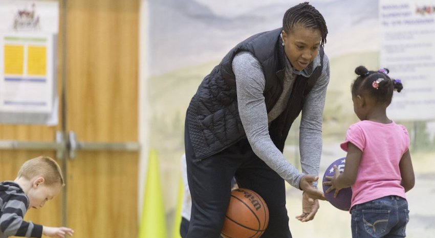 Outspoken Christian, community leader, and retired WNBA superstar Tamika Catchings works with children as part of programming for underprivileged children hosted by her Catch the Stars Foundation, pictured in this Knoxville News Sentinal photo.