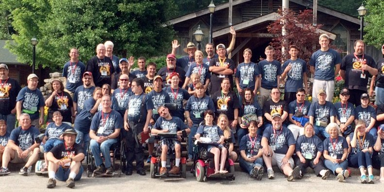 Special Touch Getaway Camp guests at the Mid-America location just west of Siloam Springs, Arkansas, show off their Kerusso Christian T-shirts in a group photo taken last year. Special Touch Ministry has operated camps for people of all ages who have intellectual and physical disabilities for 35 years.