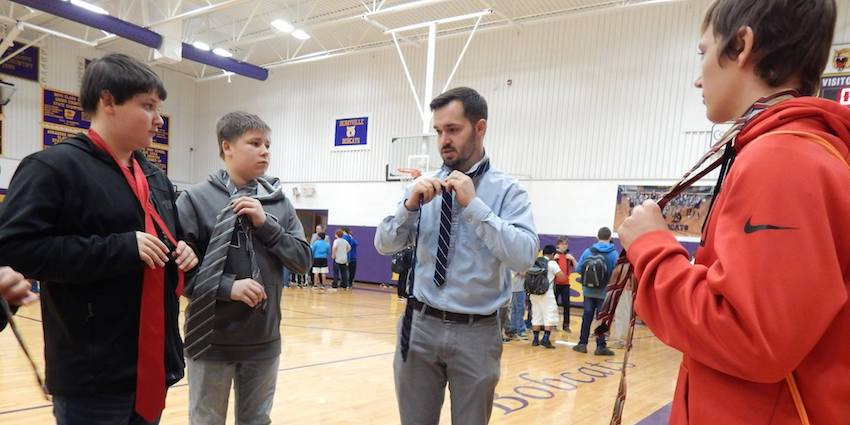 At Bright Futures' Tie Day Assembly at Berryville Middle School in March, every male student was given a tie and was placed in a small group to learn how to tie it; community volunteers led each group, showing them step-by-step how to form their tie knots until each student had it down. The mentors also talked to the young men about topics such as self-confidence and the importance of firm handshakes, making eye contact and showing respect to others.