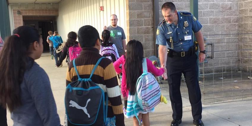 """Bright Futures Berryville volunteers Chad Hipps, a local trooper with the Arkansas State Police, and Josh Comer, youth pastor at Freeman Heights Baptist Church, were two of dozens of """"Champions"""" who greeted students every morning during standardized testing in April at Berryville's elementary, intermediate and middle schools."""
